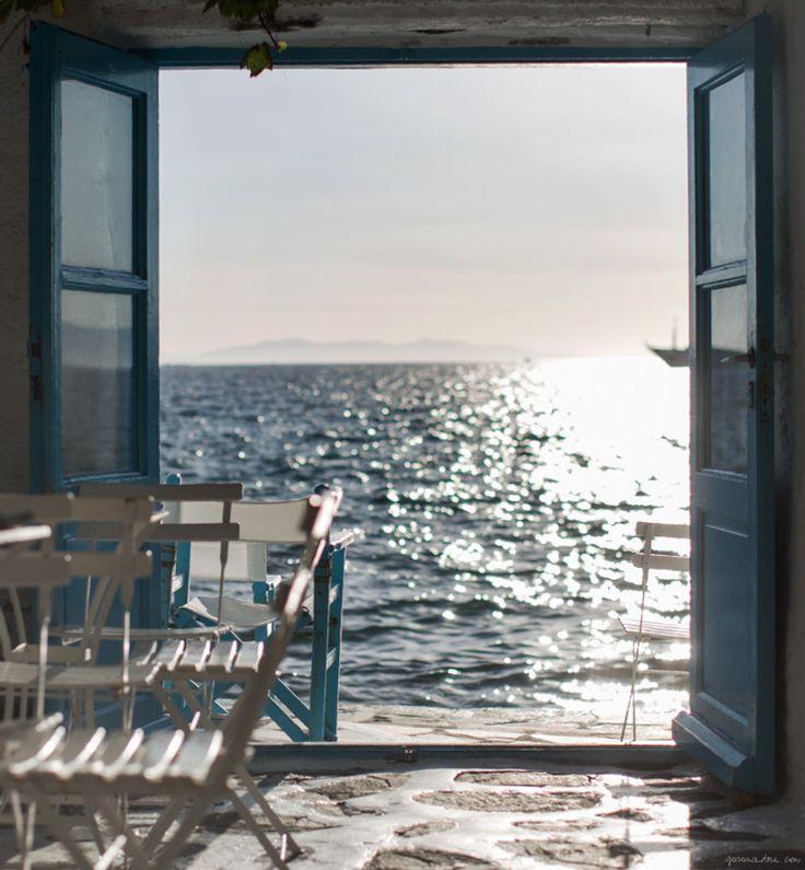 Le Caprice, Mykonos, tables, ocean, stone floor, glass doors