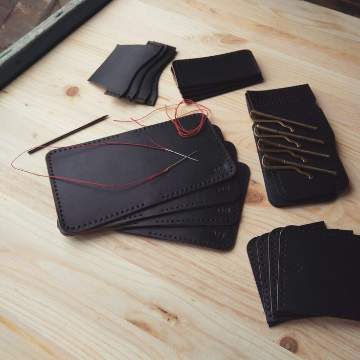 Four money clip bifold wallets in process.
