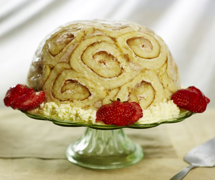 This kitsch dessert is made up of jam-filled Swiss roll with a set egg custard flavoured with raspberries, strawberries and raspberry liqueur