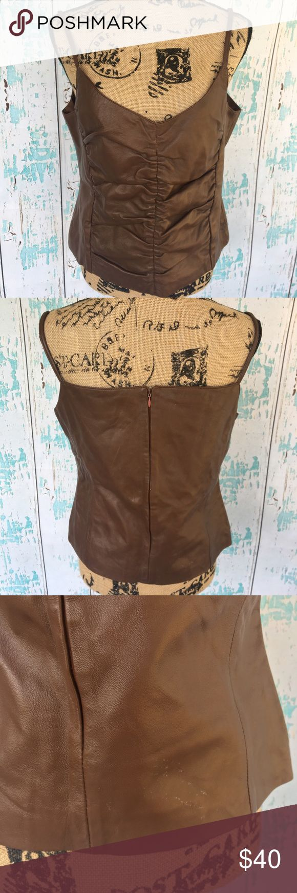 NWT British Khaki sheep leather brown tank size 10 NWT British Khaki sheep leather brown tank size 10. Looks like slight wear from storage but new with tags. British Khaki Tops Tank Tops