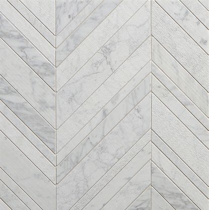 Decidedly Modern in Design sensibility. Crafted in Italy, Lucca combines a variety of smooth and textured finishes in field tiles, mosaic patterns and dimensional carved Pieces. Lucca's exciting blend of texture and dimension will lend visual drama to any space.  Lucca - White Venatino Marble Textured Chevron Mosaic - 4 piece pattern -Walker Zanger