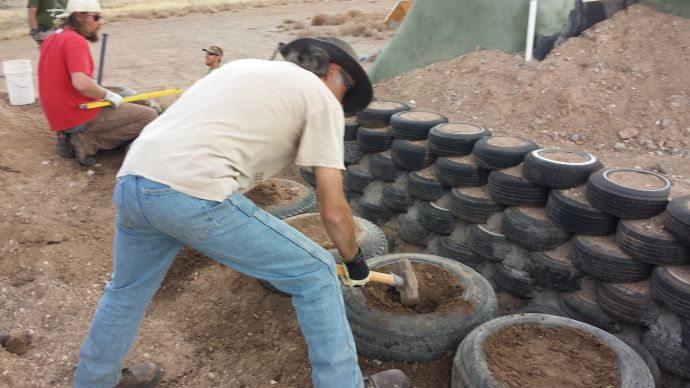 Building a tire retaining wall. | earth ship shelters/ living / gardens | Pinterest | Retaining ...