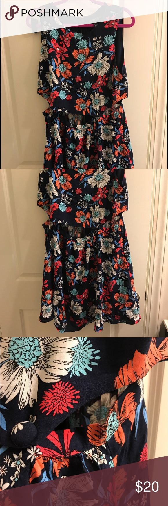 Floral dress with waist cut outs It's a floral dress that has peekaboo going on in the middle in the front and it has two buttons very cute Forever 21 Dresses