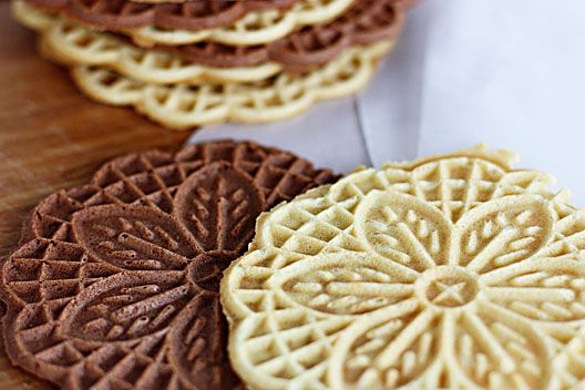 Basic Vanilla Pizzelles Recipe.  I found a pizzelle press at my local Goodwill for .99!  If you keep your eyes open at second hand stores you can find really nice ones.  They are easy, low ingredients, and super delicious.  My kids LOVE these.