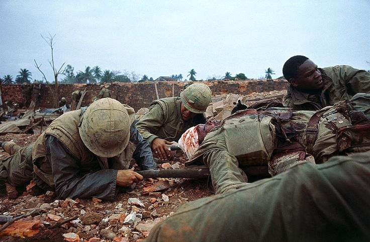 Hue 1968 - Soldiers Moving One of Their Wounded