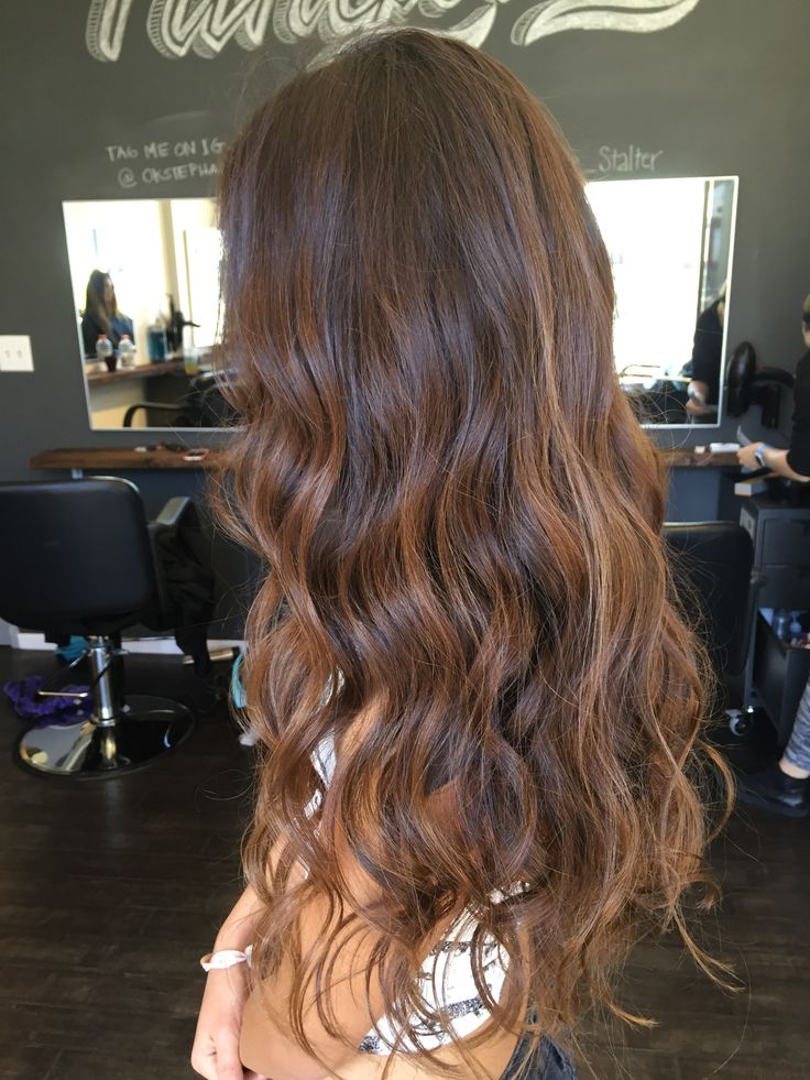 Long surfer girl hair. Added very subtle lighter balayage pieces to her natural hair.