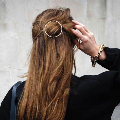 This is a Must have for your hair, straight from the runway! Minimalist Gold Circle Barrette. I have starfish, half moons, triangle and these circles available. Wear two together! This is a big Louis