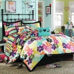 For Sale: PRICE REDUCED - $45.00 - Steve Madden Queen Comforter Set, Etc. - PRICE REDUCED - Queen comforter set - includes reversible comforter (black background w/flowers or white background w/flowers), black bed skirt, 2 shams, 2 decorative pillows, matching striped queen sheet set, lamp, green valance - $45.00  - more photos in comments