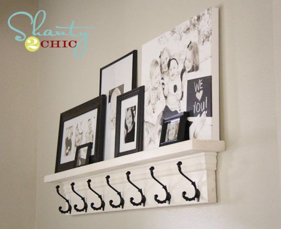 DIY Coat Hook Shelf.  Love the style and look of this  Simple white coat rack with shelf/ledge on top on neutral wall.  Photo frames different sizes black and white sit on top of ledge.