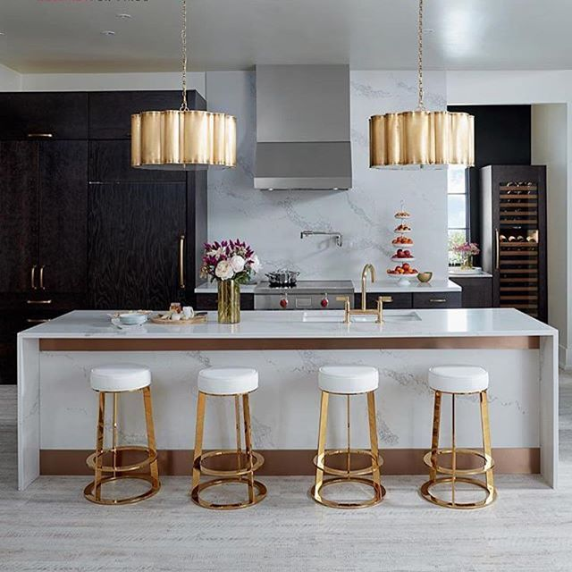 Large, gold pendant lights and Statuario Maximus go together like peanut butter and jelly! This design by Studio B Style is the most glamorous kitchen we have ever seen!