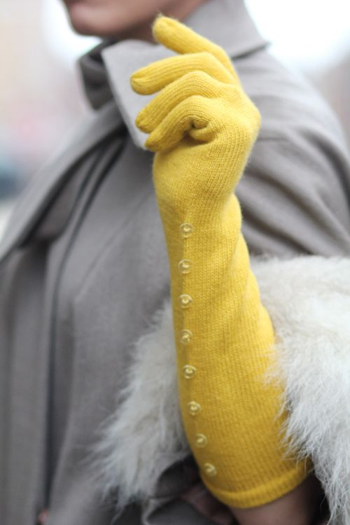 Yellow gloves pop against a grey coat. Tick Tock Vintage