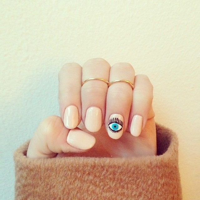 evil eye nail art with nude polish