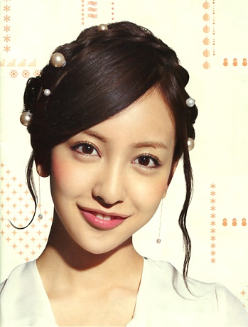 Tomomi Itano (Japanese idol, AKB48). Emobile catalogue 2013.   Pearl pin hairstyle.