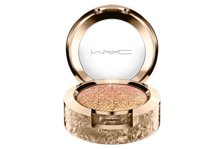 """MAC's Christmas make-up collection is called Snow Ball, and the products are all just as sparkly as the name suggests. The Extra Dimension Eye Shadow in Stylishly Merry offers a flattering wash of iridescent gold.  Charlotte Tilbury Matte Revolution in Shanghai Nights, £24. Available at [link url=""""http://www.charlottetilbury.com/uk""""]CharlotteTilbury.co.uk[/link]."""