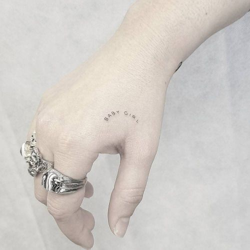 Single needle baby girl tattoo on the right hand....