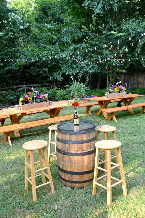 Casual Backyard Biergarten Engagement Party:  Picnic tables & whiskey barrel bistro tables with pub stools & flowers