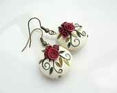 Polymer clay earrings lentil beads with roses in cream, pink and grey handmade. $16,00, via Etsy.
