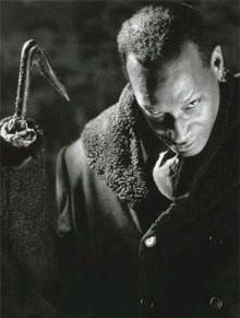 "Candyman...was the antagonist of the horror movie (1992) of the same name, although a brutal killer and demonic spirit he has an especially tragic past compared to most horror icons which arguably made him more sympathetic - though he was nevertheless just as dangerous and deadly as any other slasher movie antagonist. It was directed by Bernard Rose and is based on the short story ""The Forbidden"" by Clive Barker.  Candyman was played by Tony Todd."