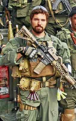 U.S. Special Forces Green Beret Daniel Devlin photographed with his Afghan Strike Force prior to an operation in eastern Afghanistan.