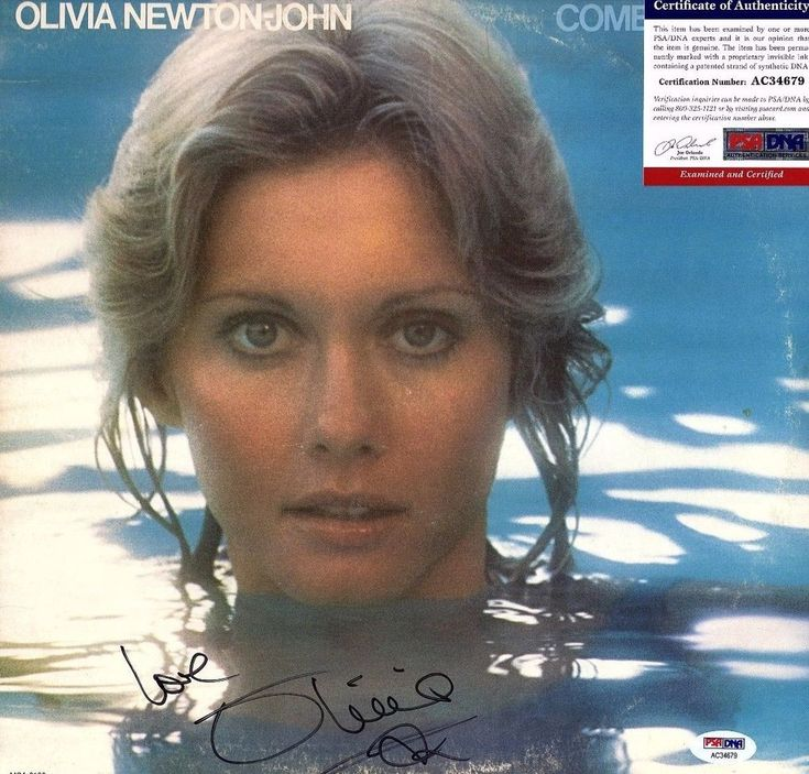 "OLIVIA NEWTON-JOHN Signed LP VINYL ""COME ON OVER"" PSA/DNA # AC34679"