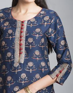 Dress up for the special occasions in this silk cotton mini kurta. The gota trim on the kurta lends it a rich look. Silk Cotton Gota Trim Round Neck with Loop Button 3Q Sleeves A-Line Fit Dry Clean Only