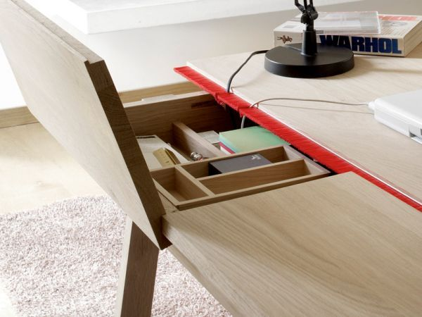 The problem with desks is usually the unaesthetic image of all the cables and wires and the lack of storage space. With the Landa Desktop none of those are a problem anymore. Designed by Samuel Accoceberry, this desk features a simple and efficient cable management system as well as hidden storage spaces. It has a minimalist and modern design and is available in three different sizes.14 Modern desk Designs For Eye-Catching Decors