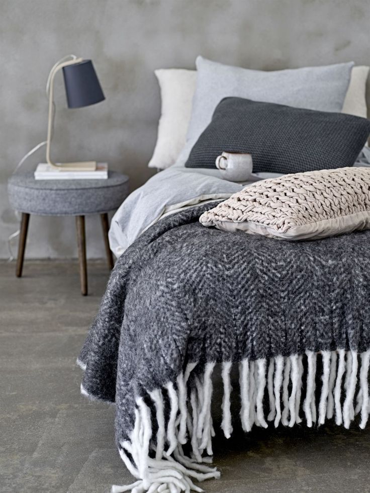 Cosy up with beautiful tactile cushions and throws. Big knits are here to stay so choose knitted cushions that have a sculptural quality and combine them with thick woven throws with contrasting fringing. You can never have too many cushions and throws, so mix and match textures and tones together to create the ultimate hygge effect this winter. (Photo: Pad Lifestyle). Find more bedroom and hygge ideas at housebeautiful.co.uk