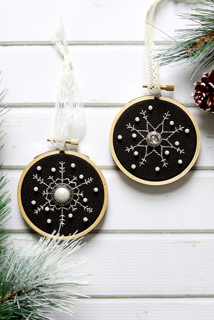 Tiny Embroidery Snowflakes: We love these beautiful snowflakes in tiny hoops on black Aida with Metallic Pearl thread. Get the tutorial on how to make these yourselves below.