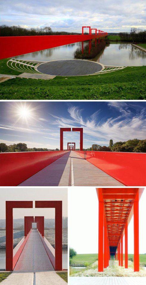 The red gateway pedestrian bridge, Cergy-Pontoise, France, designed by Dani Karavan. Cool red bridge