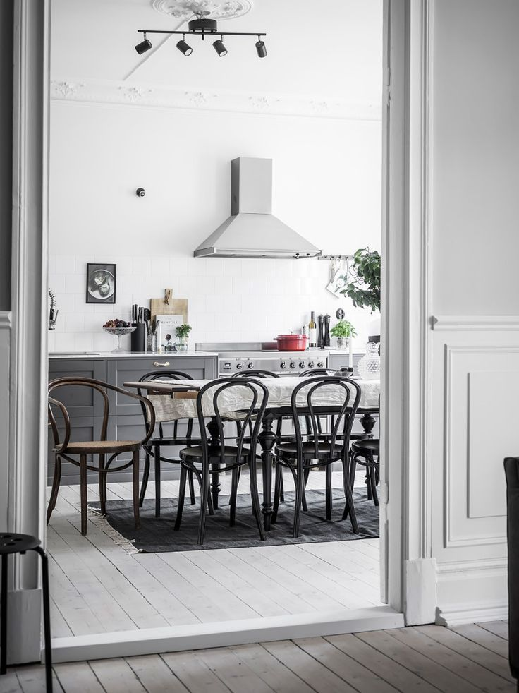 I'm drawn to this darker grey kitchen contrasting nicely with the light soaped wood flooring. The large dining table fills the middle of the space for dinner parties and I like the black Thonet chairs on the grey carpet. via … Continue reading →