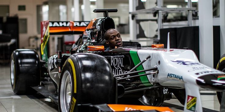 British athlete James Dasaolu inside the Force India VJM05.