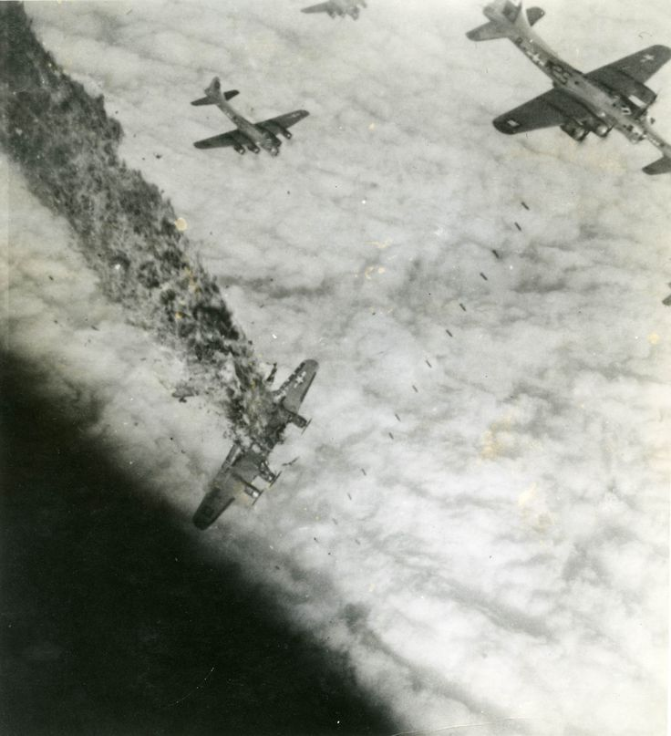 A B-17 goes down in flames after being hit by anti-aircraft fire.