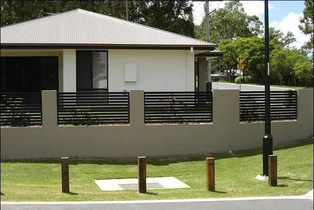 rendered brick wasll with wood inserts, this would look nice out the front