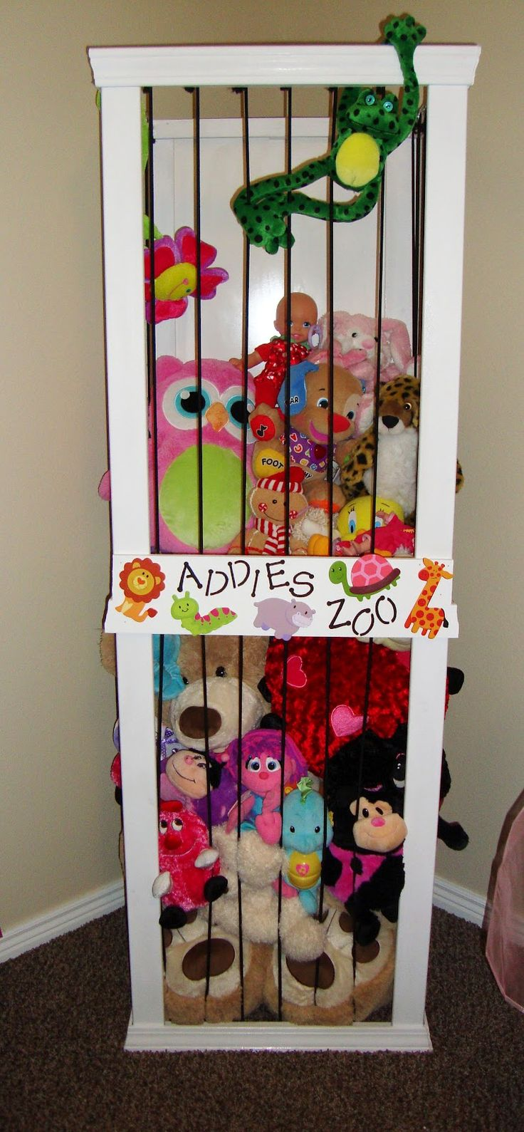 Stuffed animal storage (bungee cords). Smart! we soooo need to make this!!! lol  I wonder if we could paint it brown and make it Mater's junkyard?