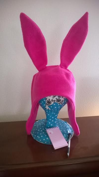 Channel your inner Louise Belcher of Bobs Burgers with this sassy pink anti-pill polar fleece bunny hat! Ears stand 7 tall and are fully posable.
