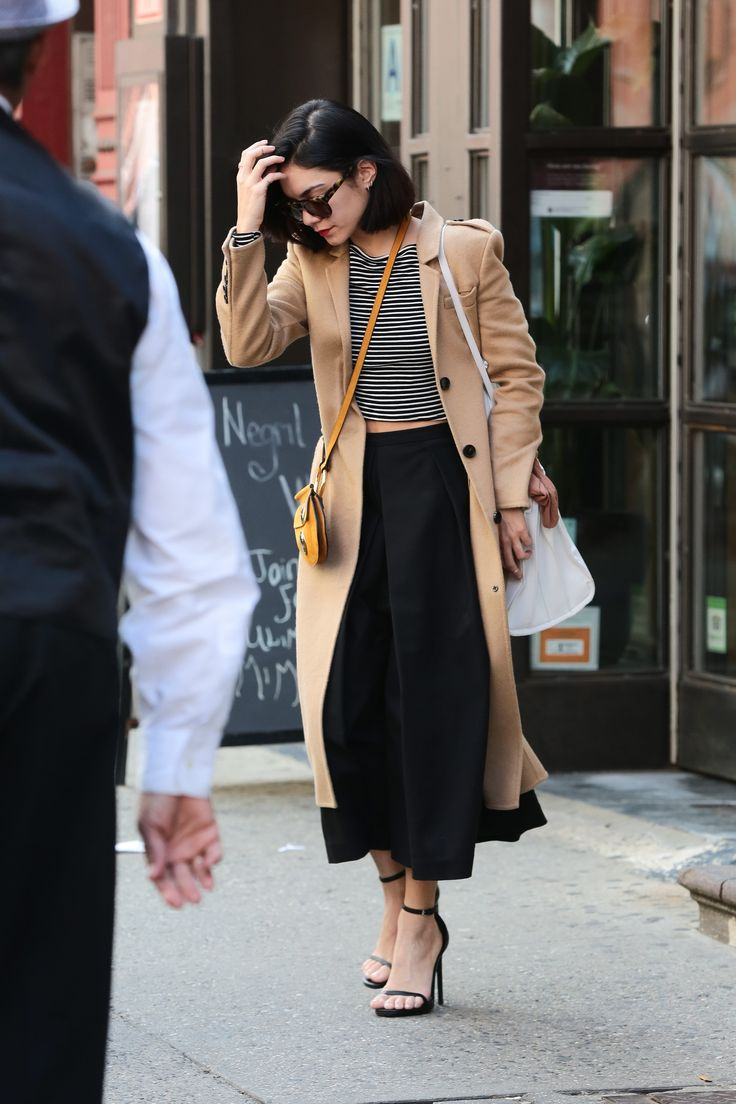For an afternoon out in NYC, she wears the downtown uniform—striped shirt, black pants, camel coat, and strappy heels.   - MarieClaire.com