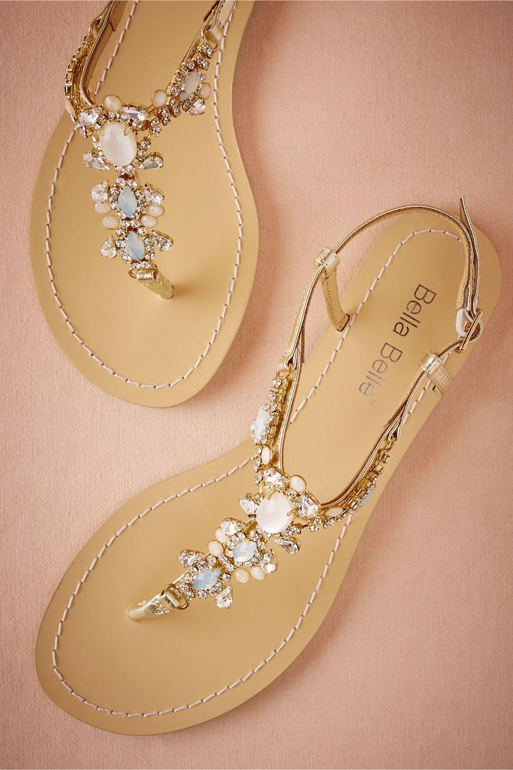Swarovski White Opal crystals decorate a breezily opulent pair of summer sandals