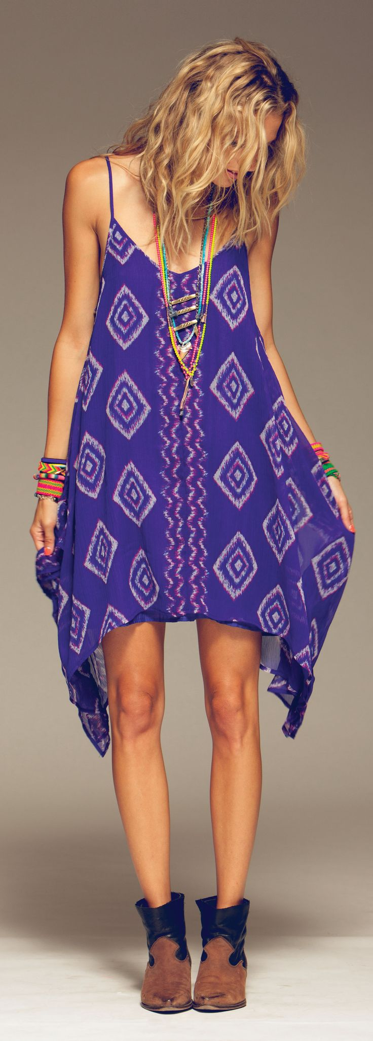 Totally... I want it.  Lovely Billabong Rapid Waves dress paired with fantastic cowboy-esque ankle boots. Cute little surf-hippy ensemble.