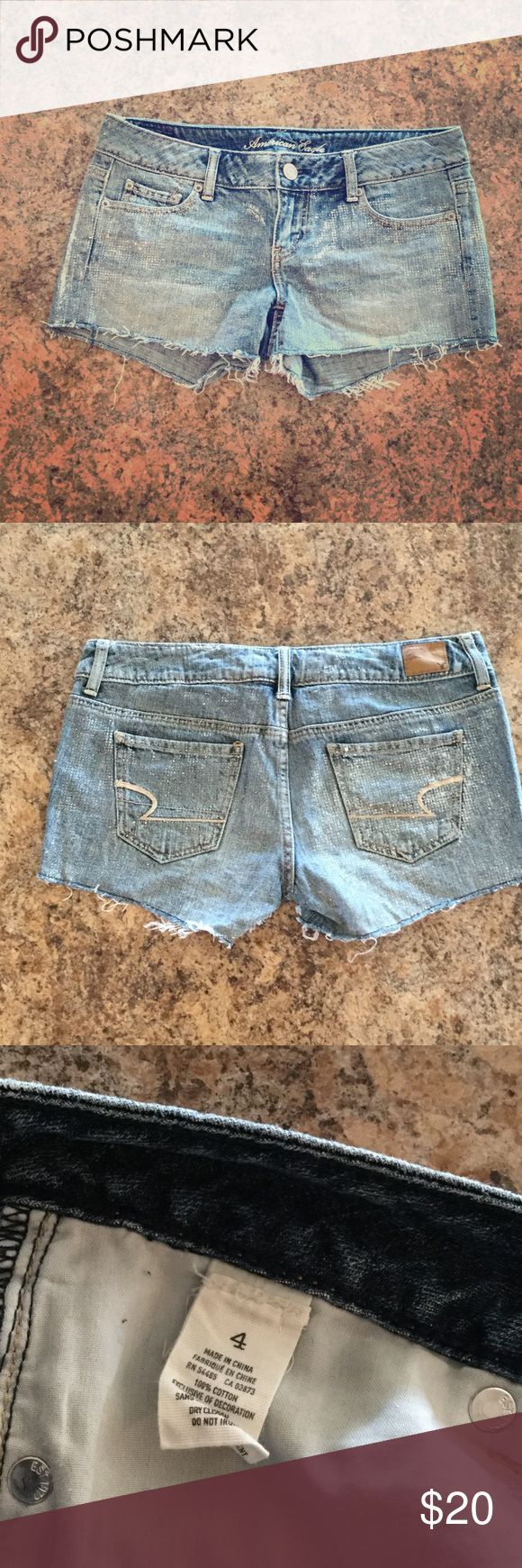 American Eagle Shorts American Eagle shorts- light/medium wash with silver sparkle, frayed bottom. Size 4 excellent condition. Feel free to make an offer! 😃 American Eagle Outfitters Shorts Jean Shorts