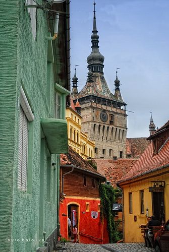 Sighişoara, Romania. I was in the top of that clock tower! The cobble stone streets there are gorgeous.