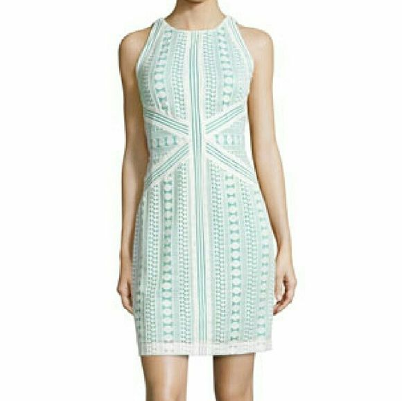 NWT Neiman Marcus Lace Sheath Dress NWT, tag brand is MUSE. Beautiful white/aquamarine color. Bought at a boutique store in nyc. Neiman Marcus Dresses Mini