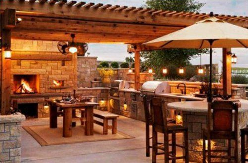 Outdoor Küche mit Grill feuerstelle beleuchtung naturstein