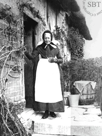 Mary Baker outside Anne Hathaway's cottage c.1895. Anne Hathaway was William Shakespeare's wife. Mary was the first custodian of the cottage, being a relative of the Hathaways.