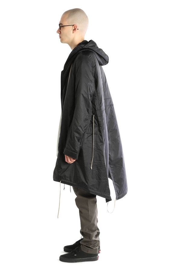 The Fishtail Parka from Rick Owens DRKSHDW Details 100% Italian featherweight nylon. Slight batting for warmth, but still perfect for mild winters and spring. Exaggerated drawcords throughout. Zip and snap front closure Fits true to size Made in Italy. Color Black. Sizing Chart M L Chest 25 26 Shoulders 16 17 Length (front) 39 40 Length (back) 48 49
