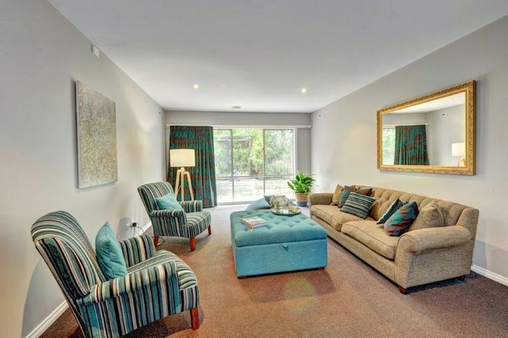 Lovely teal. Im inlove with the striped chairs too and feature curtains. What do you think?