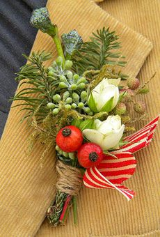boutonniere of spruce, eucalyptus, roses and moss.