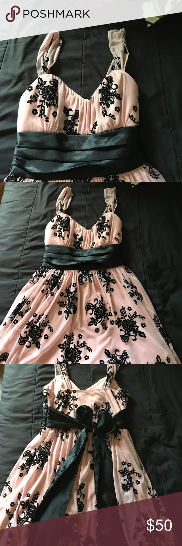 Formal dress Light pink with flower patches.                                              This dress has been worn a couple times for dinner dates and dances. Great condition. Dresses Mini