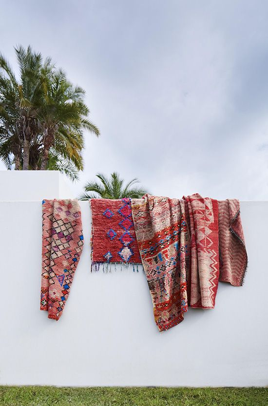 Gorgeous textiles providing a bright colour pop on a plain wall. Just goes to show that traditional  textiles can work in an otherwise contemporary and minimalist interior scheme.