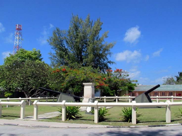 Two World War Two-era guns watch over a British war memorial on Gan Island, Addu Atoll, Maldives.