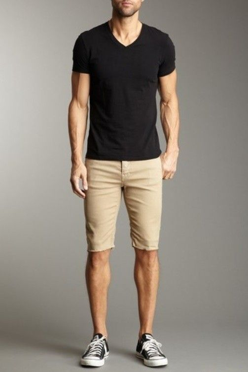 Shop this look on Lookastic:  http://lookastic.com/men/looks/black-v-neck-t-shirt-tan-shorts-black-and-white-canvas-low-top-sneakers/10407  — Black V-neck T-shirt  — Tan Shorts  — Black and White Canvas Low Top Sneakers